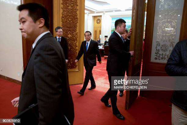 Chinese Premier Li Keqiang arrives for a meeting with French President Emmanuel Macron at the Great Hall of the People in Beijing on January 9 2018 /...