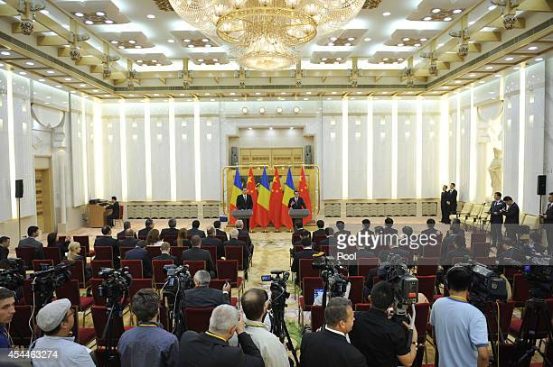 Chinese Premier Li Keqiang attends a joint press conference with Romanian Prime Minister Victor Ponta at the Great Hall of the People on September 1...