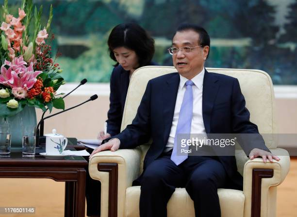 Chinese Premier Li Keqiang attends a meeting with Oliver ZipseChairman of the Manegement Board BMW Group at the Great Hall of the People on October...