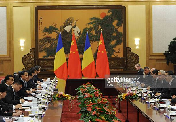 Chinese Premier Li Keqiang attends a meeting with Romanian Prime Minister Victor Ponta at the Great Hall of the People on September 1 2014 in Beijing...