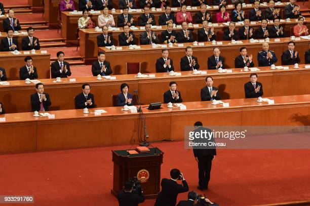 Chinese Premier Li Keqiang bows after he being elected for a second term during the sixth plenary session of the National People's Congress at the...