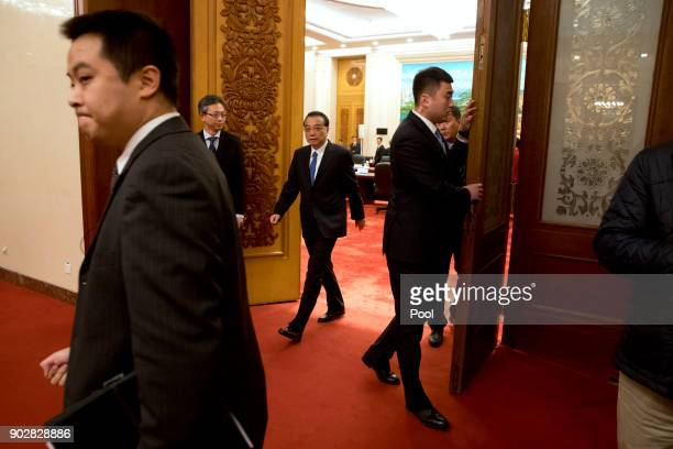 Chinese Premier Li Keqiang center arrives for a meeting with French President Emmanuel Macron at the Great Hall of the People on January 9 2018 in...
