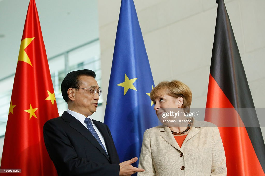 Chinese Premier Li Keqiang chats with German Chancellor Angela Merkel during a signing ceremony at Chancellery on October 10, 2014 in Berlin, Germany. The visit is Li's second visit to the country, China's biggest European trade partner, since taking office last year. During the consultations, companies from the two countries' telecommunications, automotive, and alternative energy industries are expected to sign agreements.