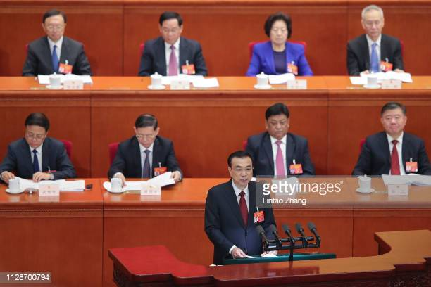 Chinese Premier Li Keqiang delivers a speech during the opening of the second session of the 13th National People's Congress at The Great Hall of...