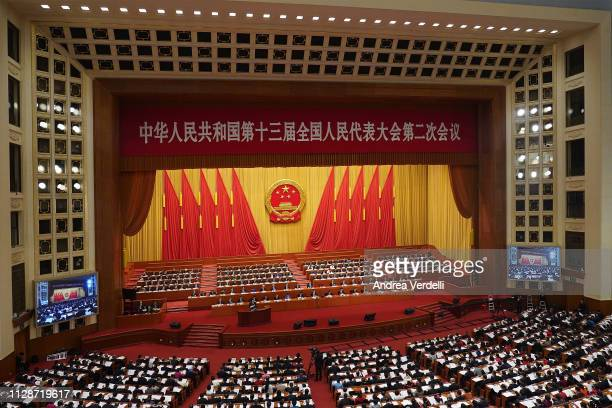 Chinese Premier Li Keqiang delivers a speech during the opening of the Two Sessions of the 13th National People's Congress at The Great Hall of...