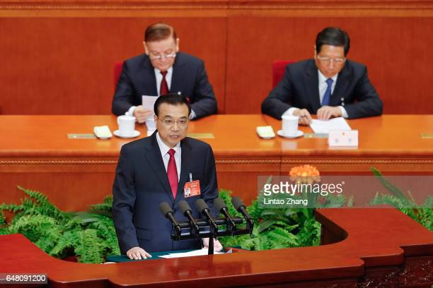Chinese Premier Li Keqiang delivers his report during the opening session of the National People's Congress at The Great Hall of People on March 5,...