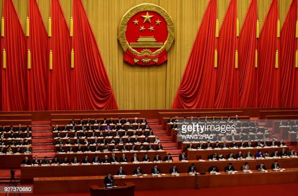 Chinese Premier Li Keqiang delivers his work report during the opening session of the National People's Congress, China's legislature, in Beijing's...