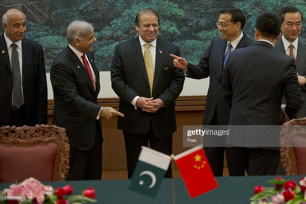 Chinese Premier Li Keqiang (3R) gestures as he speaks to Punjab Chief Minister Shahbaz Sharif (2L) asPakistan Prime Minister Nawaz Sharif (C) looks on before a signing ceremony between officials from both countries held at the Great Hall of the People on July 5, 2013 in Beijing, China, Friday. This is Sharif's first foreign visit since returning to power and he is in China to negotiate investment to help his country's own failing economy, however trade between the two countries reached an all time high last year when it exceeded 12 billion USD.