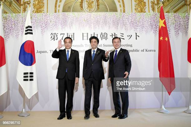 Chinese Premier Li Keqiang Japanese Prime Minister Shinzo Abe and South Korean President Moon Jaein pose for photographs prior to the ChinaSouth...