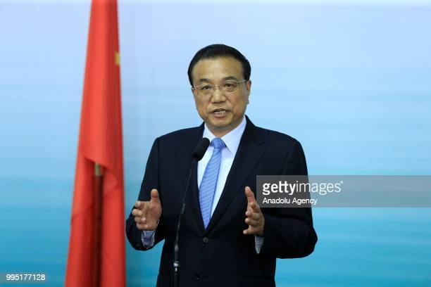 Chinese Premier Li Keqiang makes a speech during a press conference with German Chancellor Angela Merkel following a presentation on autonomous...