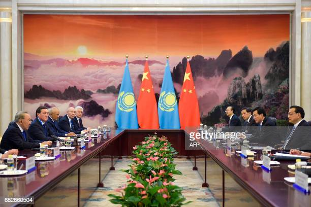 Chinese Premier Li Keqiang meets Kazakhstan's President Nursultan Nazarbayev at the Great Hall of the People in Beijing on May 14, 2017. China touted...