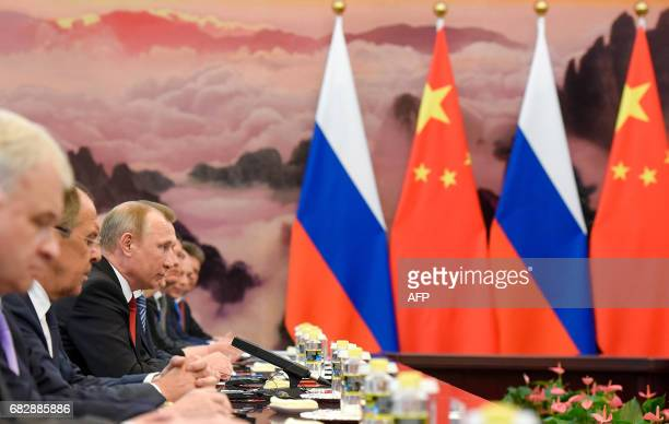 Chinese Premier Li Keqiang meets Russian President Vladimir Putin at the Great Hall of the People in Beijing on May 14 2017 China touted on Sunday...