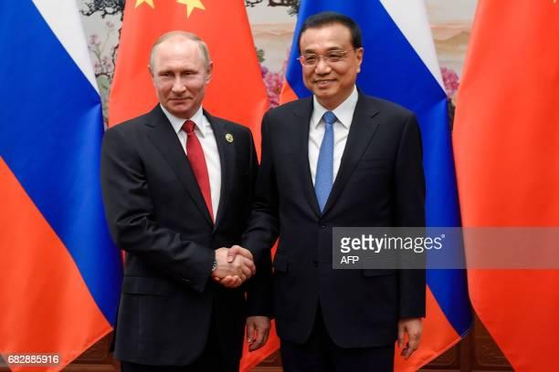 Chinese Premier Li Keqiang meets Russian President Vladimir Putin at the Great Hall of the People in Beijing on May 14, 2017. China touted on Sunday...