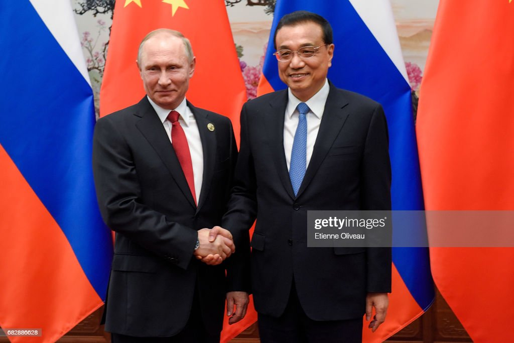 Chinese Premier Li Keqiang (R) meets Russian President Vladimir Putin (L) at the Great Hall of the People on May 14, 2017 in Beijing, China.