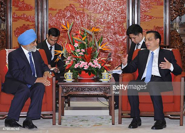 Chinese Premier Li Keqiang meets with Indian Planning Commission Deputy Chairman Montek Singh Alhuwalia at the Hall of Purple Light inside the...