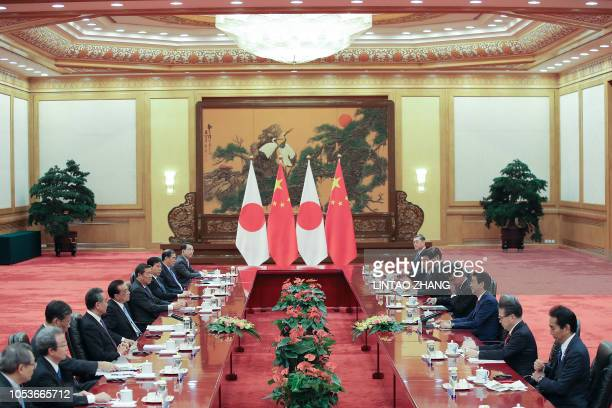 Chinese Premier Li Keqiang meets with Japanese Prime Minister Shinzo Abe inside the Great Hall of the People in Beijing on October 26 2018 Abe is on...