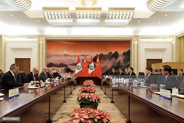 Chinese Premier Li Keqiang meets with Peruvian President Pedro Pablo Kuczynski at the Great Hall of the People in Beijing on September 14, 2016. /...