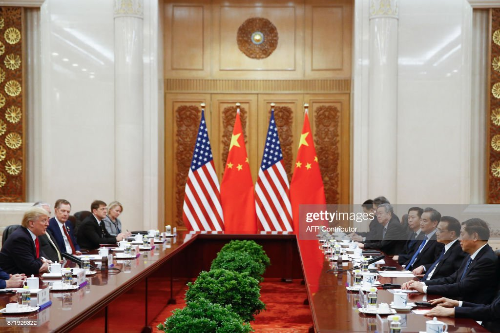 Chinese Premier Li Keqiang (2nd R) meets with US President Donald Trump (L) at the Great Hall of the People in Beijing on November 9, 2017. Donald Trump and Xi Jinping put their professed friendship to the test on November 9 as the least popular US president in decades and the newly empowered Chinese leader met for tough talks on trade and North Korea. /