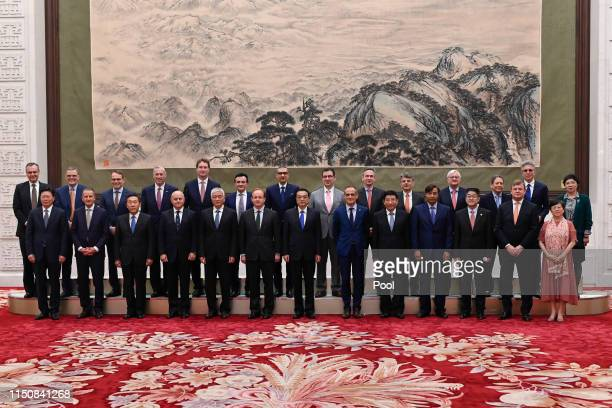 Chinese Premier Li Keqiang poses for photographs with representatives of of 7th RoundTable Summit of Global CEO Council at the Great Hall of the...