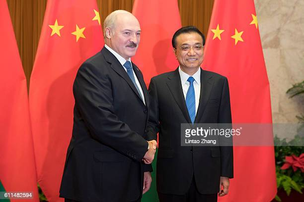 Chinese Premier Li Keqiang shakes hands with Belarusian President Alexander Lukashenko at Great Hall of the People on September 30 2016 in Beijing...