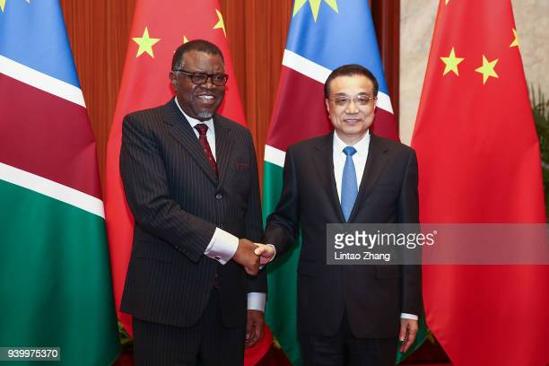 Chinese Premier Li Keqiang shakes hands with Namibia's President Hage G Geingob at The Great Hall of People on March 30 2018 in Beijing China At the...