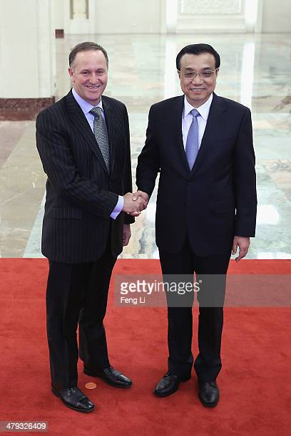 Chinese Premier Li Keqiang shakes hands with New Zealand Prime Minister John Key at the Great Hall of the People on March 18 2014 in Beijing China