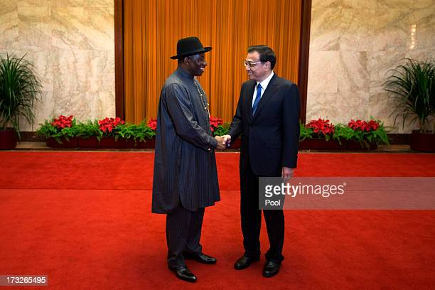 Chinese Premier Li Keqiang shakes hands with Nigerian President Goodluck Jonathan before their meeting at the Great Hall of the People on July 11...
