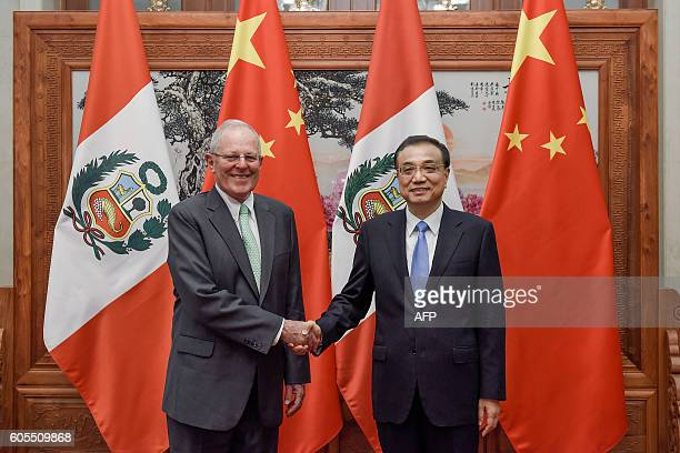 Chinese Premier Li Keqiang shakes hands with Peruvian President Pedro Pablo Kuczynski at the Great Hall of the People in Beijing on September 14,...