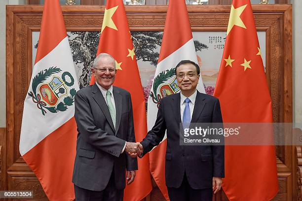 Chinese Premier Li Keqiang shakes hands with Peruvian President Pedro Pablo Kuczynski at the Great Hall of the People on September 14 2016 in Beijing...