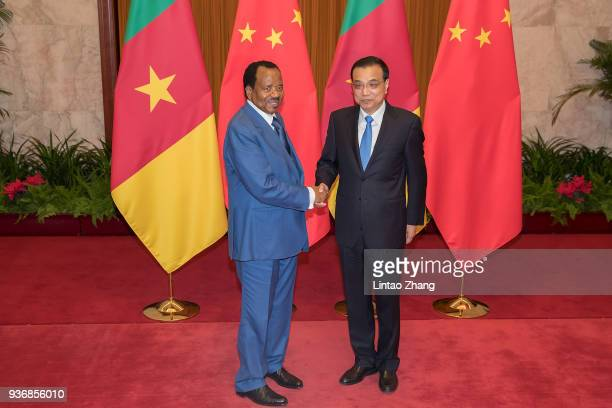 Chinese Premier Li Keqiang shakes hands with President of Cameroon Paul Biya at The Great Hall Of The People on March 23, 2018 in Beijing, China. At...