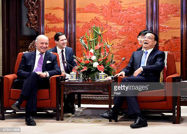 Chinese Premier Li Keqiang shares a light moment with French Foreign Minister Laurent Fabius during a meeting at the Zhongnanhai leadership compound...