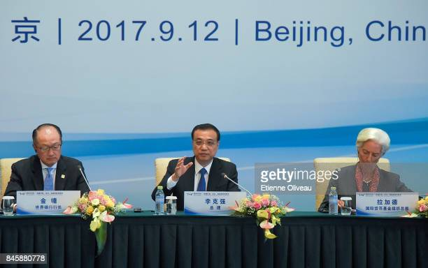 Chinese Premier Li Keqiang speaks as he seats between President Jim Yong Kim of the World Bank and Managing Director Christine Lagarde of the...