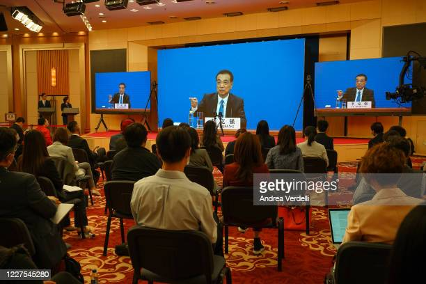 Chinese Premier Li Keqiang speaks at a video press conference from The Great Hall Of The People after the closing of the National People's Congress...
