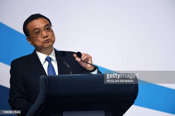 Chinese Premier Li Keqiang speaks at the 44th Singapore Lecture on the sidelines of the 33rd Association of Southeast Asian Nations summit in...