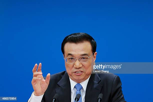 Chinese Premier Li Keqiang speaks during a press conference after the closing session of the 12th National People's Congress at the Great Hall of the...