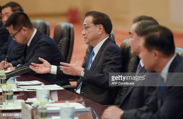Chinese Premier Li Keqiang speaks during his bilateral meeting with Brazil President Michel Temer in Beijing on September 1, 2017. / AFP PHOTO / POOL...