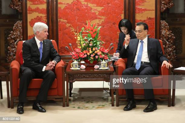 Chinese Premier Li Keqiang speaks with Michigan Governor Rick Snyder during a meeting at the Zhongnanhai Leadership Compound on August 1 2017 in...