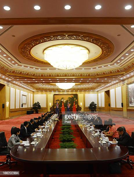 Chinese Premier Li Keqiang speaks with New Zealand's Prime Minister John Key during a meeting at the Great Hall of the People on April 10 2013 in...