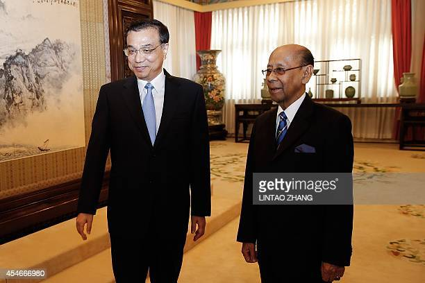 Chinese Premier Li Keqiang stands with Malaysia's King Abdul Halim Mu'adzam Shah before their meeting at Zhongnanhai in Beijing on September 5 2014...