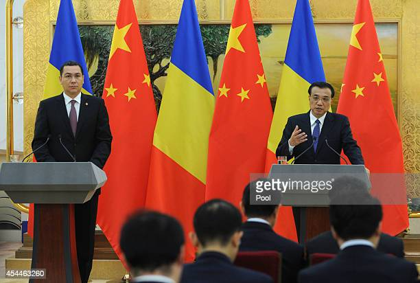Chinese Premier Li Keqiang talks during a joint press conference with Romanian Prime Minister Victor Ponta at the Great Hall of the People on...
