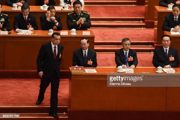 Chinese Premier Li Keqiang walks after he being elected for a second term during the sixth plenary session of the National People's Congress at the...