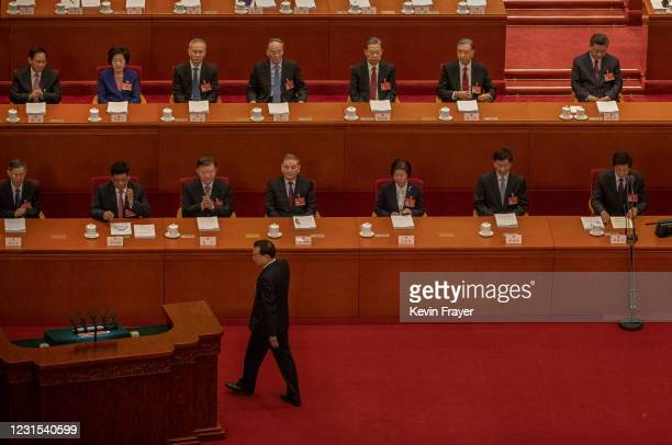 Chinese Premier Li Keqiang walks to the podium to speak as President Xi Jinping and other lawmakers gather at the opening session of the National...
