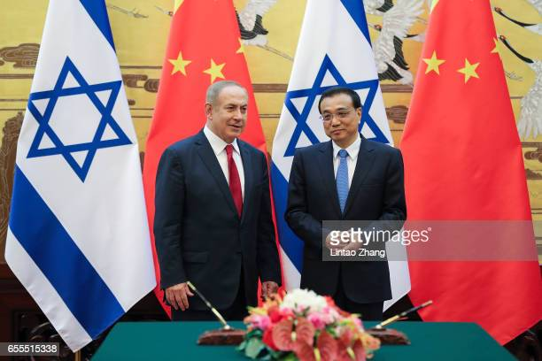 Chinese Premier Li Keqiang with Israel Prime Minister Benjamin Netanyahu attend a signing ceremony at the Great Hall of the People on March 20 2017...
