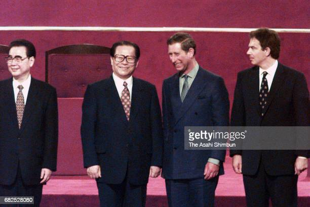 Chinese Premier Li Peng Chinese President Jiang Zemin Prince Charles Prince of Wales and British Prime Minister Tony Blair line up after the Handover...