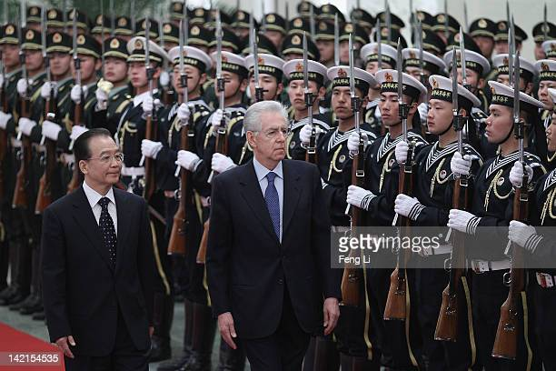Chinese Premier Wen Jiabao accompanies Italian Prime Minister Mario Monti to view an honour guard during a welcoming ceremony at the Great Hall of...