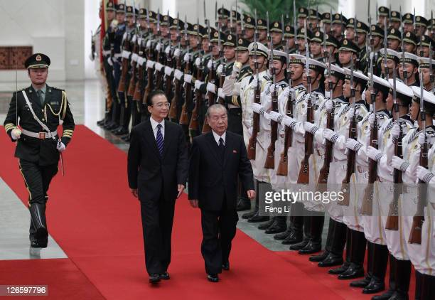 Chinese Premier Wen Jiabao accompanies Premier of Democratic People's Republic of Korea Choe Yong Rim to view a guard of honour during a welcoming...