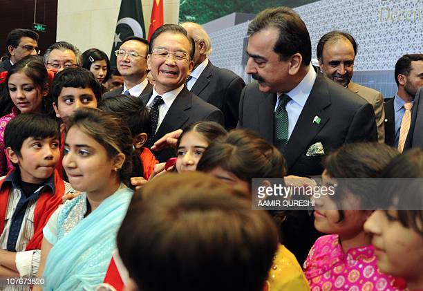 Chinese Premier Wen Jiabao and his Pakistani cournterpart Yousuf Raza Gilani meet with Pakistani children after performing a musical tableau at the...