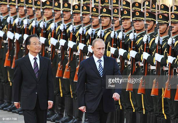 Chinese Premier Wen Jiabao and Russian Prime Minister Vladimir Putin attend a welcome ceremony at the Great Hall of the People on October 13, 2009 in...