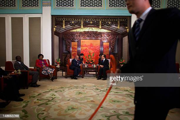 Chinese Premier Wen Jiabao and South African President Jacob Zuma listens to translators during their meeting at the Hall of Purple Light inside the...