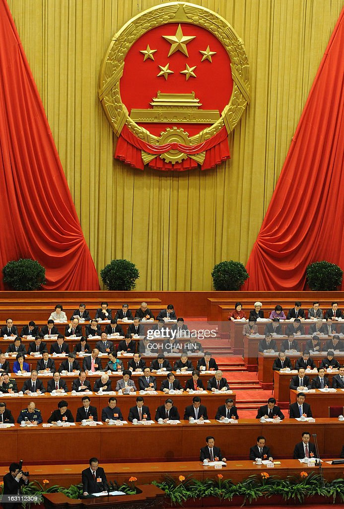 Chinese Premier Wen Jiabao (lower 2nd L) delivers his final report at the opening session of the Chinese National People's Congress (NPC) at the Great Hall of the People in Beijing on March 5, 2013. China set its economic growth target for this year at 7.5 percent, unchanged on 2012, ahead of the opening on March 5 of the annual parliament session of the world's second-largest economy.